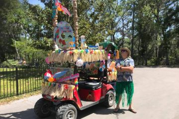 Proud golf cart owner with a tropical display