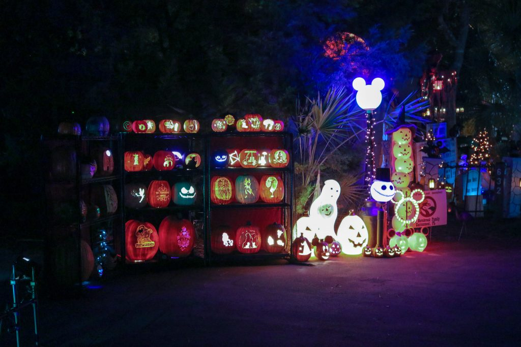 A campsite that has 3 Shelves full of Pumpkins Decorated for Halloween at Fort Wilderness